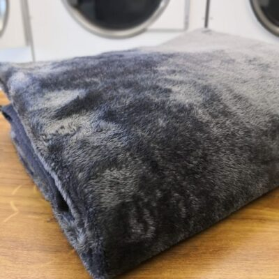 Folded clean mink blanket in laundry