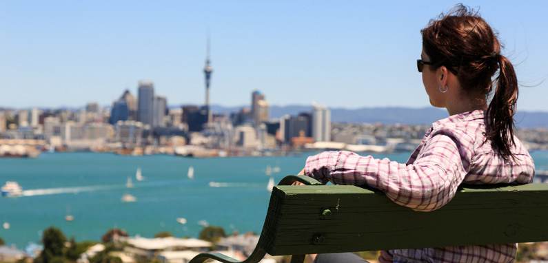 woman on bench overlooking city